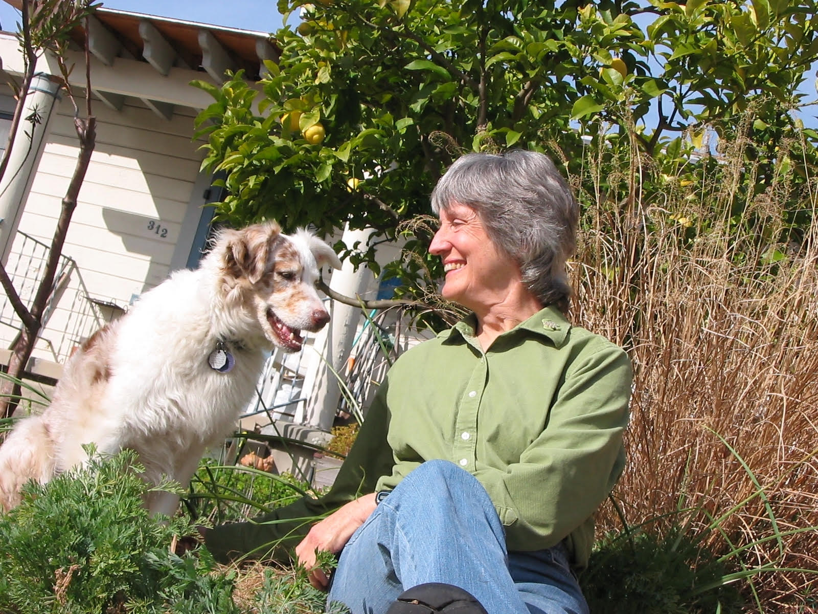 Donna Haraway outside with dog