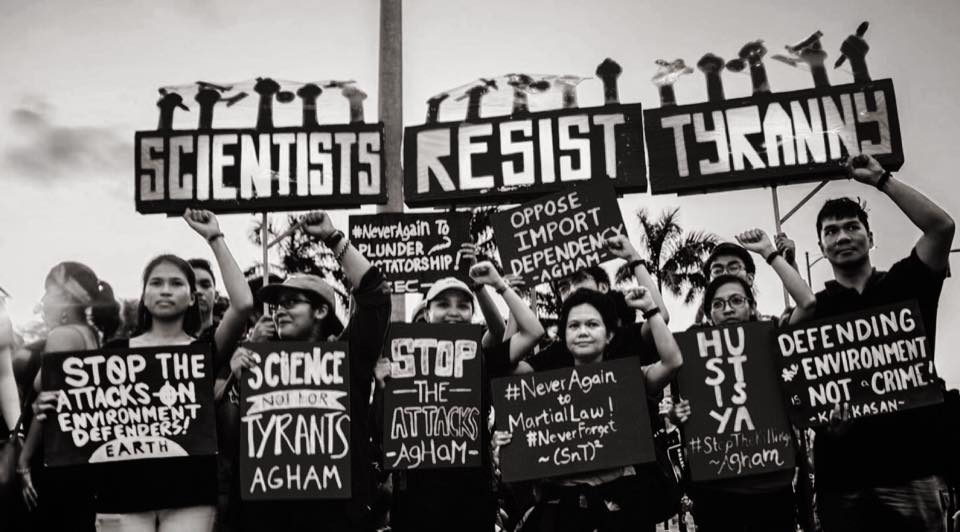 Scientists Resist Tyranny protest signs